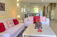 Living room, dining room and kitchen, Las Olas Residence, luxury rental in Las Terrenas