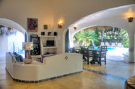 Living room with view to the pool and garden, Villa Chinola of Las Terrenas